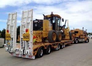 Low loader truck for out of gauge cargo
