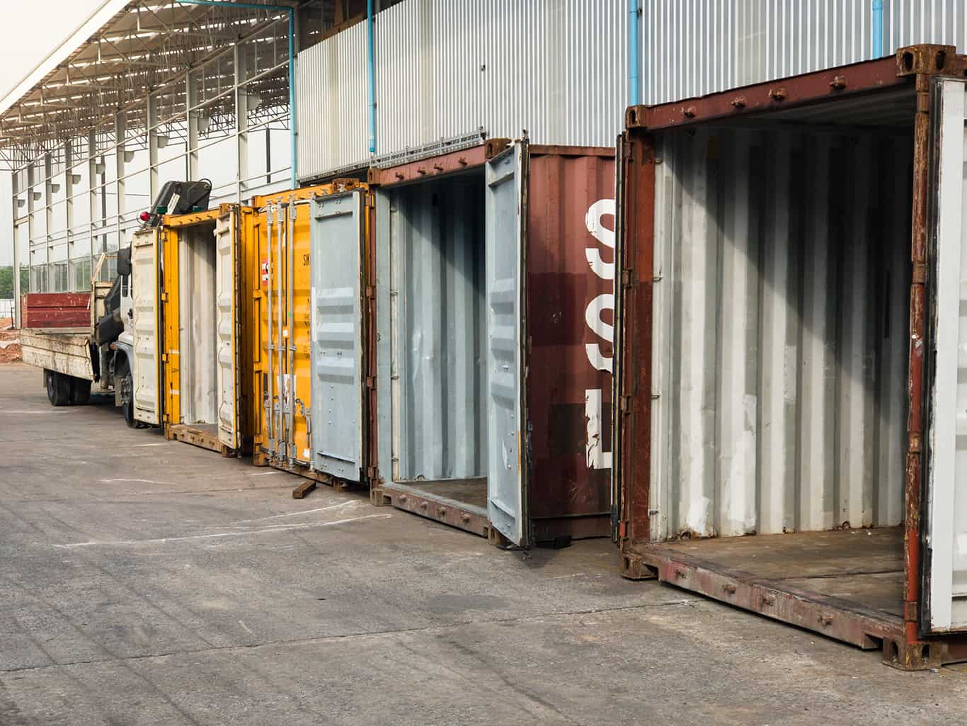 Stack of Cargo empty Containers at warehouse
