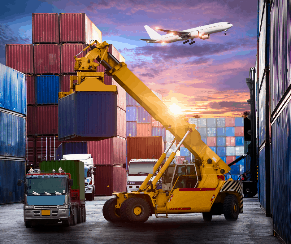 A container handling forklift truck moving a cargo container onto a truck