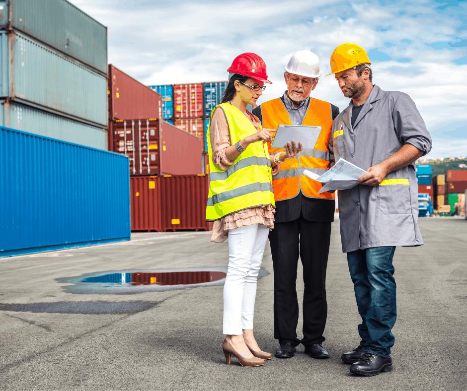 Cargo workers finalising shipping information