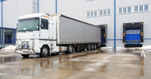 unloading container trucks at warehouse